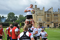 Tom Ellis of Bath Rugby wins the ball at a lineout. Bath Rugby training session on September 4, 2015 at Farleigh House in Bath, England. Photo by: Patrick Khachfe / Onside Images