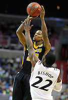 Laurence Bowers of the Tigers shoots over Rashad Bishop of the Bearcats. Cincinnati defeated Missouri 78-63 during the NCAA tournament at the Verizon Center in Washington, D.C. on Thursday, March 17, 2011. Alan P. Santos/DC Sports Box