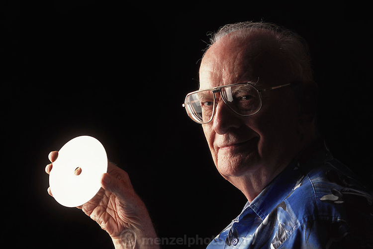 """Colombo, Sri Lanka.Sir Arthur C. Clarke holds a DVD copy of the movie 2001: A Space Odyssey. Clarke wrote, """"Any sufficiently advanced technology is indistinguishable from magic."""" Referring to the DVD in his hand, he said, """"If I were able to give Thomas Edison this disc, he would have no idea of what it was or how it worked. It would be magic."""" (He has post-polio syndrome) Best known for the book 2001: A Space Odyssey. MODEL RELEASED"""