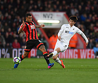 Swansea City's Ki Sung-Yueng (R) tackles Bournemouth's Joshua King (L)<br /> <br /> Bournemouth 2 - 0 Swansea<br /> <br /> Photographer David Horton/CameraSport<br /> <br /> The Premier League - Bournemouth v Swansea City - Saturday 18th March 2017 - Vitality Stadium - Bournemouth<br /> <br /> World Copyright &copy; 2017 CameraSport. All rights reserved. 43 Linden Ave. Countesthorpe. Leicester. England. LE8 5PG - Tel: +44 (0) 116 277 4147 - admin@camerasport.com - www.camerasport.com