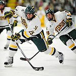 12 December 2009: University of Vermont Catamount forward Jonathan Higgins, a Senior from Stratham, NH, takes a shot against the St. Lawrence University Saints at Gutterson Fieldhouse in Burlington, Vermont. The Catamounts shut out their former ECAC rival Saints 3-0. Mandatory Credit: Ed Wolfstein Photo