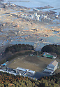 Large SOS written on the grounds of Shitsugawa Middle School 3.51pm on March 12th, 2011 where survivors wait for rescue in one of the few buildings left standing after a huge Tsunami devastated Minami Sanriku-cho, Miyagi Prefecture on Friday March 11th, 2011.