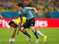 Edinson Cavani of Uruguay and Carlos Sanchez of Columbia