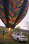 """Hot air balloonists  at the 2008 Shenandoah Valley Hot Air Balloon Festival at Historic Long Branch in Millwood, Virginia fire a propane burner to heat the air in the balloon """"envelope"""" to keep the balloon upright.  Since hot air rises, this causes the balloon to stand up, and eventually fly."""