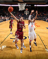 Nov 6, 2010; Charlottesville, VA, USA; Roanoke College g/f Clay Lacy (24) shoots the ball next to Virginia Cavaliers f Akil Mitchell (25) Saturday afternoon in exhibition action at John Paul Jones Arena. The Virginia men's basketball team recorded an 82-50 victory over Roanoke College.