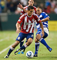 CARSON, CA – June 18, 2011: Chivas USA forward Chris Cortez (27) and FC Dallas midfielder Daniel Hernandez (2) during the match between Chivas USA and FC Dallas at the Home Depot Center in Carson, California. Final score Chivas USA 1, FC Dallas 2.