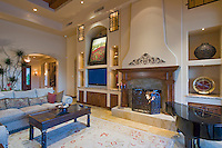 Most elegnt fireplace is seen in Mediterranean decore family room