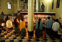 Maya people kneeling and praying in Templo El Calvario church in Coban, Alta Verapaz, Guatemala