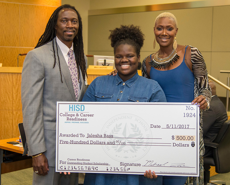 Houston ISD Trustee Jolanda Jones poses for a photograph with College and Career Readiness scholarship recipient Jalesha Bass and Kenneth Davis during a Houston ISD Board of Trustee meeting, May 11, 2017.