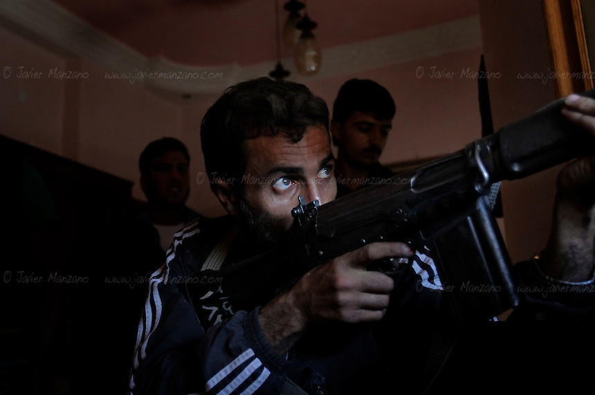 A Free Syria Army sniper prepares to fire at regime forces in the al-Aqoob district of Aleppo...© Javier Manzano..