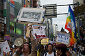 October 15, 2011, Tokyo, Japan - Protesters march through the streets of Shinjuku during an Occupy Tokyo demostration. Around 500 protesters took part in 3 separate protests in support of the Occupy Tokyo movement. The protesters airing a series of issues including Anti-Nuclear, Anti-Capitalism and Anti-TPP. They chanted '1% no thank you' and ' Nuclear no thank you ' at the rallies. Protesters in the Roppongi's Mikawadai Park numbered about 60 and were out numbered by around 70 Police and 40 members of the media. (Photo by Bruce Meyer-Kenny/AFLO) [3692]