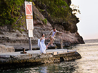 Couple jumping in the water after getting married at Jade Mountain Resort, St. Lucia.