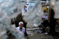 A man surveys damage to bulldozers that were being used to demolish Gezi Park, and after math of recent protests, Thursday, June 6, 2013, in Istanbul, Turkey. (Seamus Travers/pressphotointl.com)