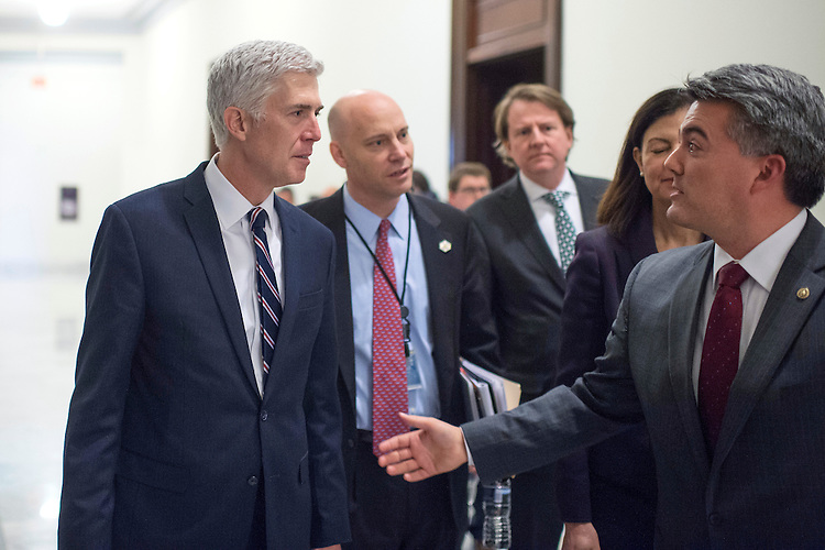 UNITED STATES - FEBRUARY 01: Supreme Court nominee Neil Gorsuch, left, greets Sen. Cory Gardner, R-Colo., before a meeting in Russell Building, February 1, 2017. (Photo By Tom Williams/CQ Roll Call)