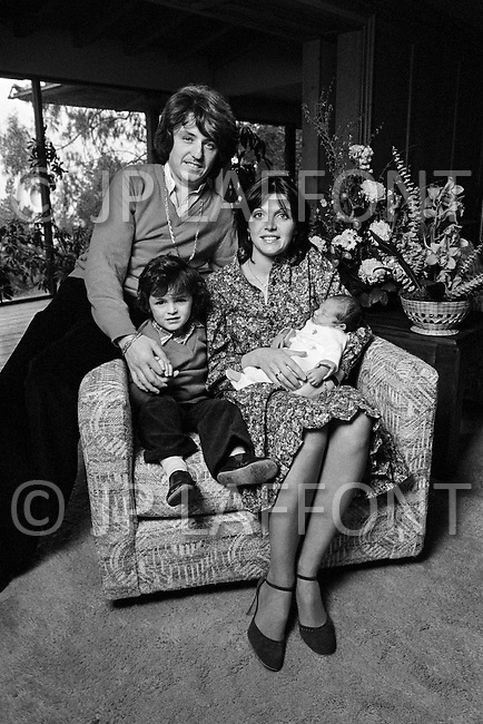30 Jan 1979, Los Angeles, California, USA --- French composer disco-music producer Marc Cerrone, his wife Florence, their three year old son Jeremy, and baby Gregory, only several days old, at home in Los Angeles. --- Image by © JP Laffont