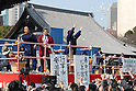 People try to catch thrown roasted soy beans and snacks at Tokyo's Zojoji temple as part of the Setsubun festival which marks the lunar calendar start of spring. The beans are supposed to drive away the evil spirits that bring misfortune and bad health with them.