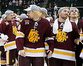 Max Tardy (Duluth - 19), Keegan Flaherty (Duluth - 14), Jake Hendrickson (Duluth - 15), Luke McManus (Duluth - 21) - The University of Minnesota-Duluth Bulldogs celebrated their 2011 D1 National Championship win on Saturday, April 9, 2011, at the Xcel Energy Center in St. Paul, Minnesota.