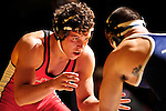 12 MAR 2011:James Myers of Olivet takes on Justin Bonitatis of TCNJ  in the fifth place competition for the 165 lbs weight class during the Division III Men's Wrestling Championship held at the La Crosse Center in La Crosse Wisconsin. Stephen Nowland/NCAA Photos