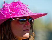 LEXINGTON, KENTUCKY - APRIL 08: A woman wears a fancy hat by the paddock on Blue Grass Stakes Day at Keeneland Race Course on April 8, 2017 in Lexington, Kentucky. (Photo by Scott Serio/Eclipse Sportswire/Getty Images)