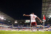 Thierry Henry (14) of the New York Red Bulls takes a corner kick during the first half against the Houston Dynamo during a Major League Soccer (MLS) match at Red Bull Arena in Harrison, NJ, on August 10, 2012.