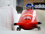 15 December 2007: Great Britain 2 pilot Jackie Davies, with Kelly Thomas on the brakes, head down the straightaway towards Turn 16 during their second run of the FIBT World Cup Bobsled Competition at the Olympic Sports Complex on Mount Van Hoevenberg, at Lake Placid, New York, USA. ..Mandatory Photo Credit: Ed Wolfstein Photo
