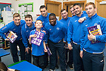 St Johnstone players visit Fairview School in Perth.....19.12.13<br /> Ben Chapman gets a selection box from David Wotherspoon, Tam Scobbie, Sanil Jahic, Nigel Hasselbaink, Paddy Cregg, Brian Easton, Gary Miller and Liam Caddis<br /> Picture by Graeme Hart.<br /> Copyright Perthshire Picture Agency<br /> Tel: 01738 623350  Mobile: 07990 594431