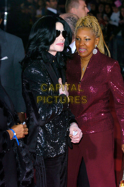 MICHAEL JACKSON.Arrivals at World Music Awards 2006, Earls Court, London, UK..November 15th, 2006.half length black sequins sequined suit jacket sunglasses shades .CAP/CAN.©Can Nguyen/Capital Pictures