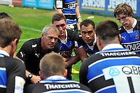 First team coach Brad Davis and the Bath players listen to captain Matt Banahan speak after their opening two matches. J.P. Morgan Premiership Rugby 7s match, between Bath Rugby and Exeter Chiefs on July 27, 2012 at Kingsholm Stadium in Gloucester, England. Photo by: Patrick Khachfe / Onside Images