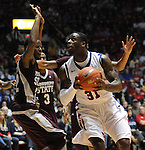 Mississippi's Murphy Holloway (31) drives against Mississippi State's Brian Bryant (22) at the C.M. &quot;Tad&quot; Smith Coliseum in Oxford, Miss. on Wednesday, January 18, 2012. Mississippi won 75-68. (AP Photo/Oxford Eagle, Bruce Newman).