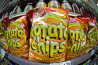 A display of house brand potato chips are seen in a supermarket in New York on Friday, May 25, 2012. A study by Harvard University recently published in the New England Journal of Medicine states that potato chips are the biggest source of obesity  with Americans putting on a pound a year. The reason cited is the same as the advertising slogan, you can't eat just one.  (© Richard B. Levine)