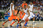 31 MAR 2012: Guard Doron Lamb (20) from the University of Kentucky tries to dribble past guards Russ Smith (2) and teammate Peyton Siva (3) from the University of Louisville during the Semifinal Game of the 2012 NCAA Men's Division I Basketball Championship Final Four held at the Mercedes-Benz Superdome hosted by Tulane University in New Orleans, LA. Ryan McKeee/ NCAA Photos.