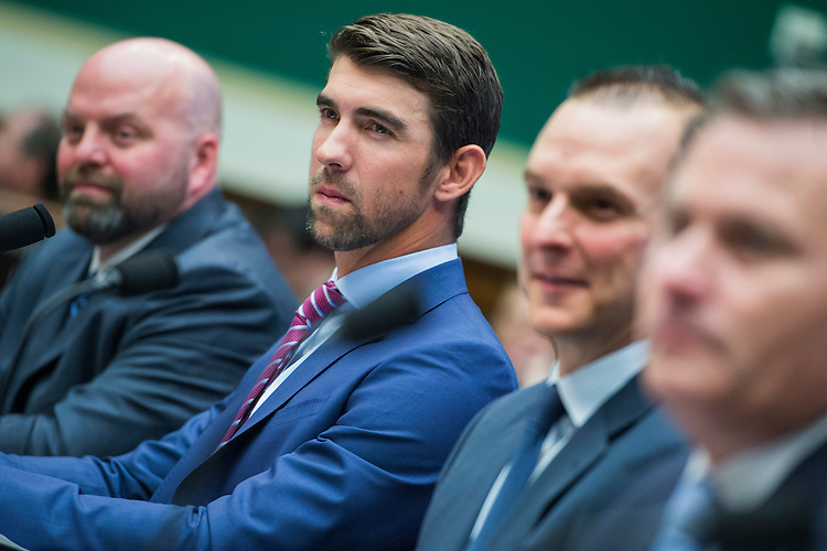 UNITED STATES - FEBRUARY 28: From left, Olympic gold medalists Adam Nelson and Michael Phelps, Travis Tygart, CEO of the U.S. Anti-Doping Agency, and Rob Koehler of the World Anti-Doping Agency, testify during a House Energy and Commerce Subcommittee on Oversight and Investigations hearing in Rayburn Building on ways to strengthen the international anti-doping system, February 28, 2017. Phelps is a swimmer and Nelson a shot putter. (Photo By Tom Williams/CQ Roll Call)