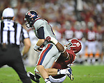 Ole Miss quarterback Bo Wallace (14) is sacked by Alabama defensive lineman Ed Stinson (49) at Bryant-Denny Stadium in Tuscaloosa, Ala. on Saturday, September 29, 2012. Alabama won 33-14. Ole Miss falls to 3-2.