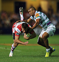 Henry Trinder is tackled by Jonathan Joseph. J.P. Morgan Premiership Rugby 7s Final, between Gloucester Rugby and London Irish on August 3, 2012 at the Recreation Ground in Bath, England. Photo by: Patrick Khachfe / Onside Images