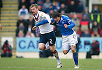 St Johnstone v Rangers...14.01.12  .Dorin Goian blocks off the run of Fran Sandaza.Picture by Graeme Hart..Copyright Perthshire Picture Agency.Tel: 01738 623350  Mobile: 07990 594431