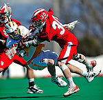 19 March 2011: University of Vermont Catamount Attacker/Midfielder Garrett Virtue, a Sophomore from Rye, NY, is checked by Midfielder Ryan Herits, a Senior from Metuchen, NJ, during action against the St. John's University Red Storm at Moulton Winder Field in Burlington, Vermont. The Catamounts defeated the visiting Red Storm 14-9. Mandatory Credit: Ed Wolfstein Photo