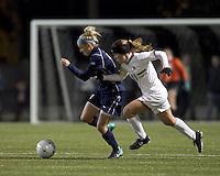 "West Virginia forward Megan Mischler (7) dribbles as Boston College defender Hannah Cerrone (11) closes. Boston College defeated West Virginia, 4-0, in NCAA tournament ""Sweet 16"" match at Newton Soccer Field, Newton, MA."