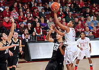 STANFORD, CA - January 3, 2015: Stanford Cardinal plays the Colorado Buffaloes at Maples Pavilion. The Cardinal defeated the Buffaloes 62-55. Amber Orrange (33) breaks her career-high scoring record with this shot.
