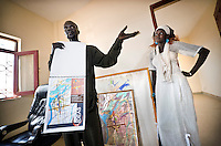 A city engineer shows plans, maps and drawings illustrating how Bentiu could develop in the coming years. South Sudan.