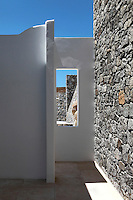 patio with stone walls<br /> <br /> A Greek businessman who wanted a holiday home near the water chose the island of Mykonos in Greece to build this 600 sq mt. home for his family of five.