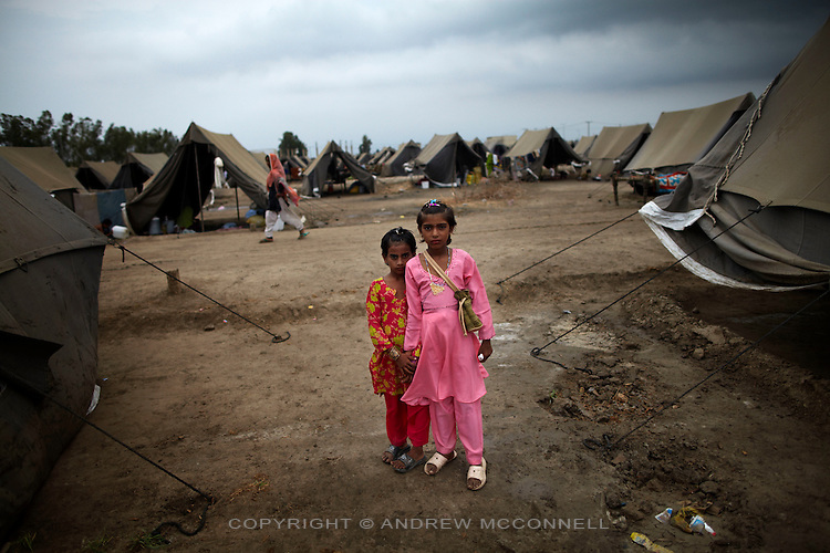 Young sisters dress up to celebrate Eid in a displaced persons camp in Sukkur, in Sindh Province, Pakistan.