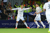 Cardiff City Stadium, Cardiff, South Wales - Tuesday 12th Aug 2014 - UEFA Super Cup Final - Real Madrid v Sevilla - <br /> <br /> Real Madrid&rsquo;s Christiano Ronaldo(L) celebrates after scoring his teams 2nd goal of the game. <br /> <br /> <br /> <br /> <br /> Photo by Jeff Thomas/Jeff Thomas Photography