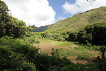 Hawaii: Molokai, scenic view of Halawa Valley, with hike in past taro fields, ancient walls, to waterfalls, guided by Lawrence Aki..Photo himolo217-72381.Photo copyright Lee Foster, www.fostertravel.com, lee@fostertravel.com, 510-549-2202