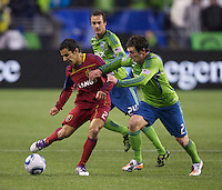Real Salt Lake defender Tony Beltran gets control of the ball in front of Seattle Sounders FC forward Mike Fucito, right, and forward Roger Levesque during play in a Major League Soccer Wester Conference Semifinal match at CenturyLink Field in Seattle Wednesday November 2, 2011. The Sounders won the match 2-0, but lost the series.