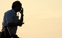 Tema Manager talks on the radio as sunsets during the race