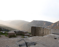 DELPHI, GREECE - APRIL 12 : A general view of 2 exedras located on the area of the Halos or threshing-floor with the mountains of the Mount Parnassus in the distance, on April 12, 2007 in the Sanctuary of Apollo, Delphi, Greece. An exedra is a semi-circular building with seats where people used to meet. (Photo by Manuel Cohen)