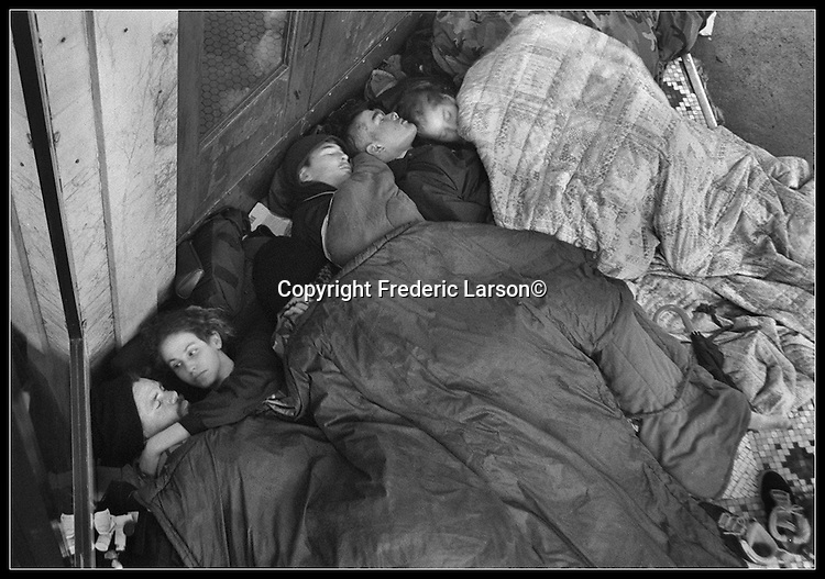 Argyle  (Jiimy Cox) and Valery (far left) spend the night out of the rain in a store front on Haight Street along with other teenage homeless kids. Argyle before his death by a Muni train was inimate with Valery.  Both sleeping on store front steps to stay out of the rain on Haight Street.