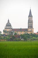 A massive and impressive Catholic Church and surrounding Rice fields in Vu Thu District, Thai Binh province, Vietnam