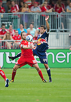 August 21 2010 New York Red Bulls defender Carlos Mendes #44 and Toronto FC forward Mista #10 in action during a game between the New York Red Bulls and Toronto FC at BMO Field in Toronto..The New York Red Bulls won 4-1