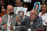 Mexican poet and activist Javier Sicilia points out to Democratic Revolution Party (PRD) candidate Andres Manuel Lopez Orador, while Emilio Avarez listens, during the dialogue with members of the National Movement for Peace with Justice and Dignity (MPJD) in the Alcazar del Castillo de Chapultepec venue in Mexico City, May 28. 2012. Sicilia and the mothers of disappeared people demanded peace to Mexico and the punishment of the authorities linked to the organized crime in Mexico. Photo by Heriberto Rodriguez
